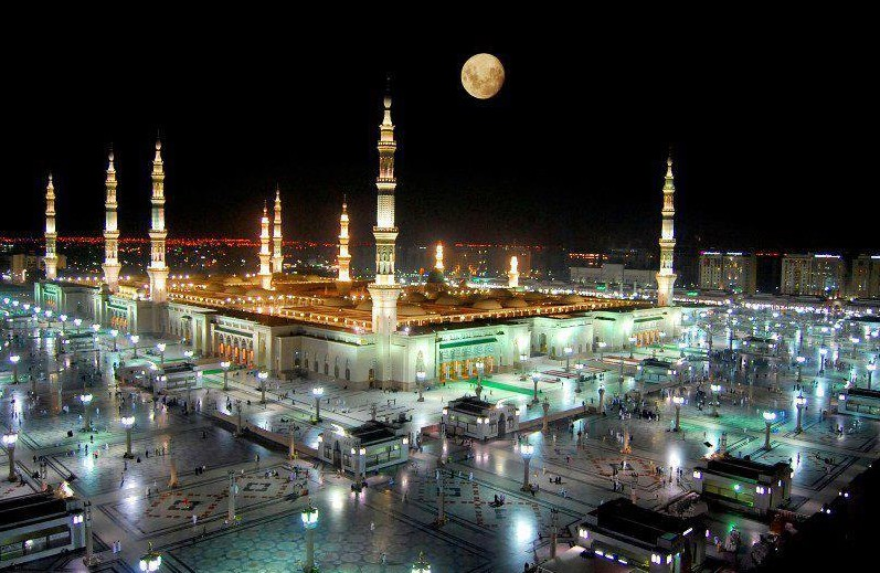 Photos of Madina A dreamy night view of Masjid an Nabawi Madina with full moon overhead Pictures of Madina